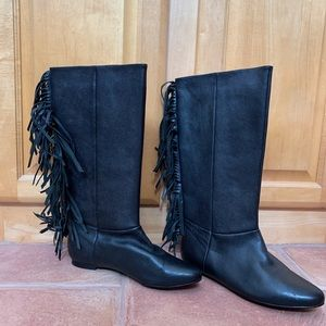 Black leather boots with fringe